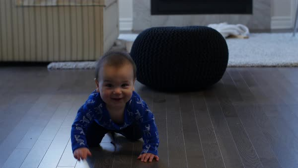 Baby boy learning to crawl on hardwood floor Royalty-free stock video