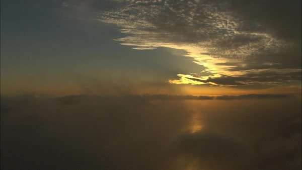 Aerial shot of clouds above the ocean at sunset Royalty-free stock video