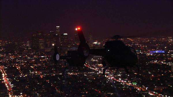 Handheld shot of helicopters flying over an illuminated city Royalty-free stock video