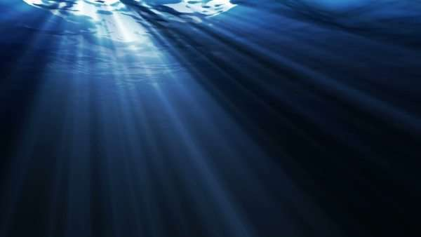 Underwater ocean waves, with light rays. Royalty-free stock video