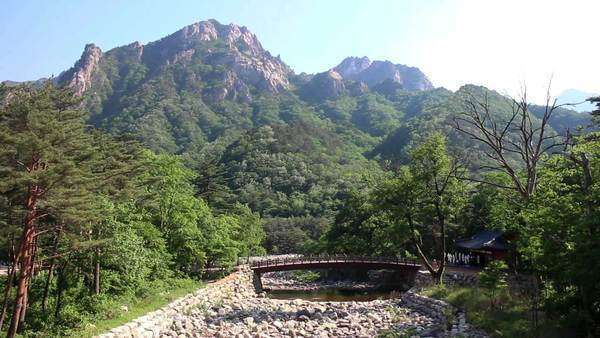 A nearly dried-out river next to a temple amidst the Seoraksan mountain range, the backbone of the Korean peninsula. Royalty-free stock video