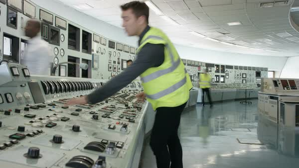 Time lapse of busy team of engineers working together inside power station Royalty-free stock video