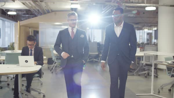 Colleagues walking through modern office Royalty-free stock video