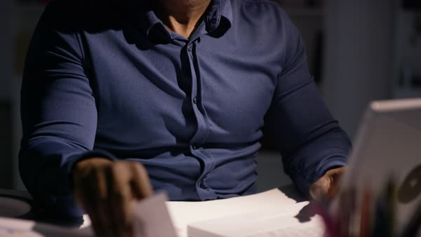 Overworked businessman working late is given extra pile of paperwork Royalty-free stock video