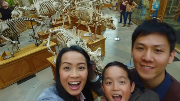 Happy family having fun in museum and video recording themselves Royalty-free stock video