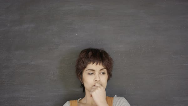 Close up portrait serious pensive woman on blank chalkboard background Royalty-free stock video
