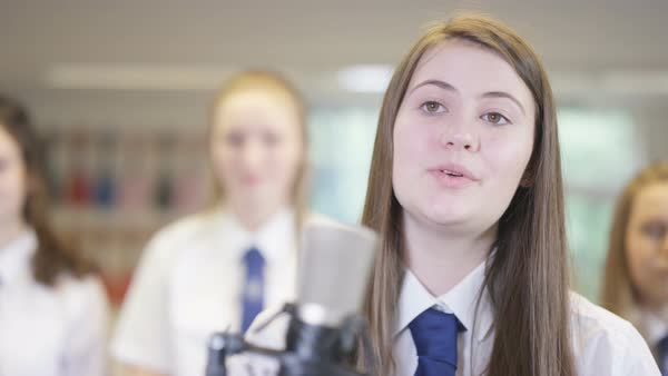 Young female student singing a solo in school music class Royalty-free stock video