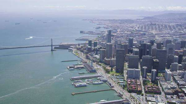Aerial view of San Francisco Business Center, cityscape and Oakland Bay Bridge Royalty-free stock video