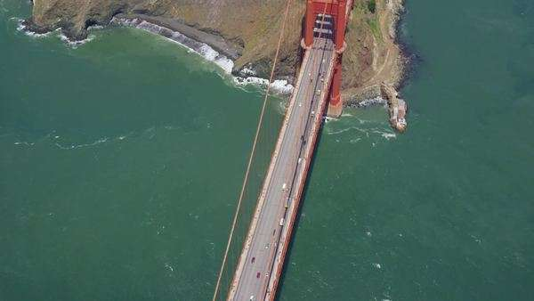 Aerial helicopter view of the Golden Gate Bridge of San Francisco City Bay area in west coast California. Flying directly over the bridge towers. Royalty-free stock video
