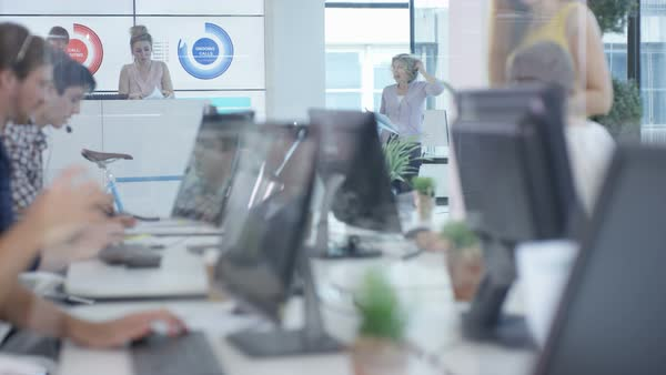 Telesales team in busy call center celebrate making a sale. Royalty-free stock video