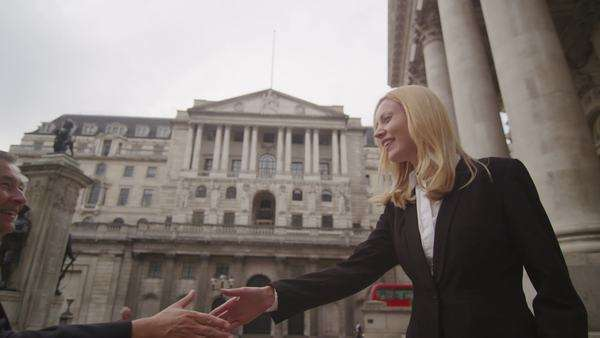 Business people greet and shake hands outside city offices Royalty-free stock video