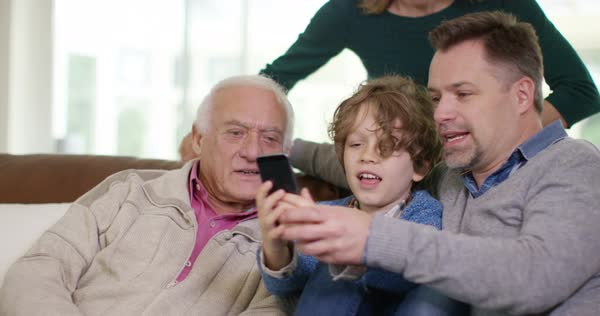 Family generations - 3 generations of family pose for selfie with camera phone. Royalty-free stock video