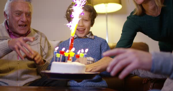 Family generations birthday party - whole family blowing out candles on the birthday cake. Royalty-free stock video