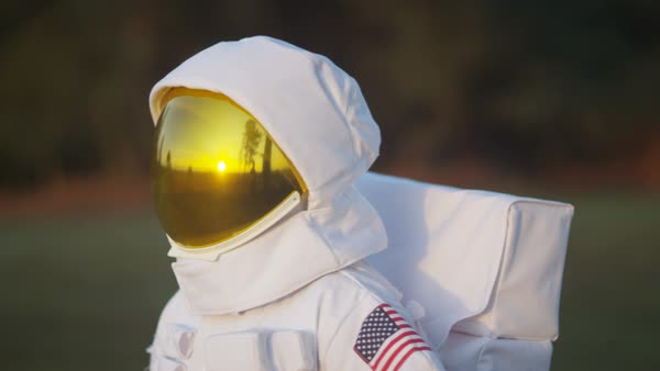 Astronaut walking in woodland area looking for signs of life. Royalty-free stock video