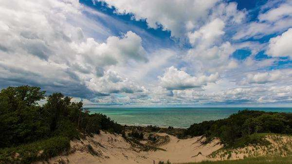 Clouds pass over lake Michigan dunes timelapse Royalty-free stock video