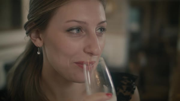 Close-up of young woman smiling and drinking champagne Royalty-free stock video