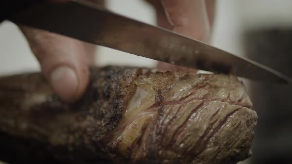 Close-up of hands slicing grilled fatty meat Royalty-free stock video