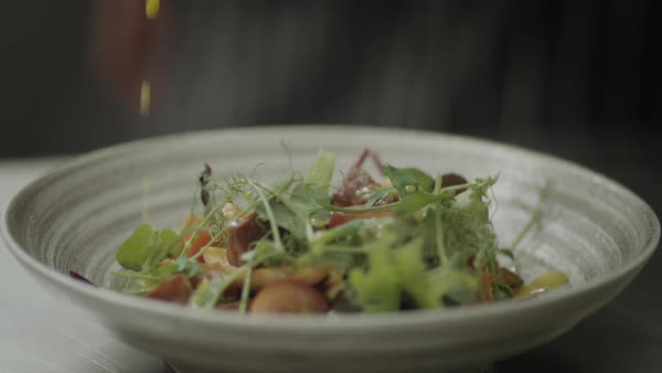 Slow motion close-up of dressing poured on fresh salad Royalty-free stock video