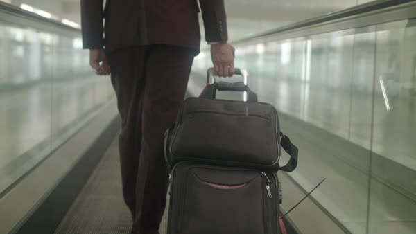 Tracking shot of a man pulling his suitcase Royalty-free stock video