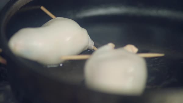 Hand-held shot of a person frying stuffed squid in a pan Royalty-free stock video