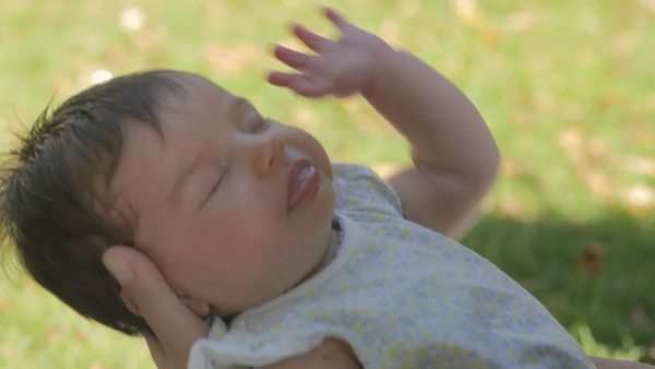 Medium shot of a baby sleeping in her mother's hand Royalty-free stock video