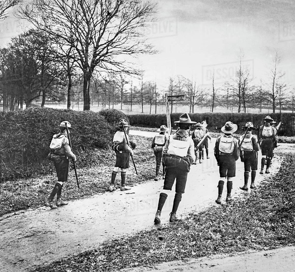 Magic lantern slide circa 1900 Victorian Social History Boy scouts trekking  along a path stock photo