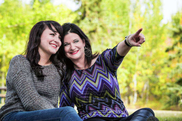 Mother and daughter spending quality time together outdoors in a city park in autumn; St. Albert, Alberta, Canada Royalty-free stock photo