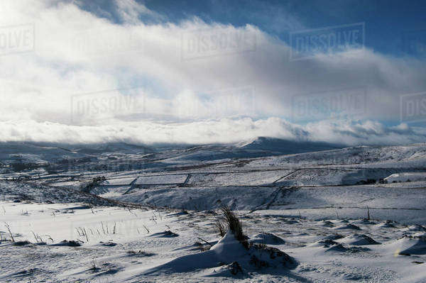 Clouds sweeping over upper Wensleydale hills following a snow storm; Wensleydale, Yorkshire, England Royalty-free stock photo