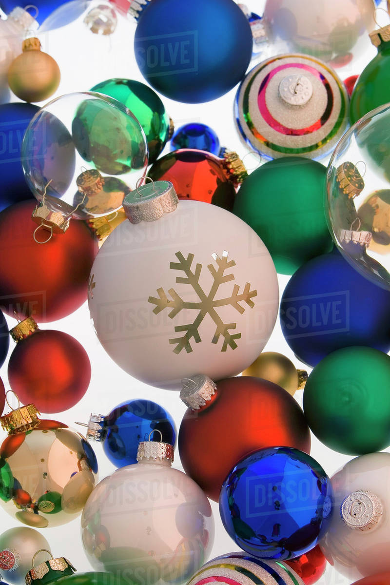 Colorful Christmas.Variety Of Colorful Christmas Tree Ball Ornaments Piled On White Background Studio Portrait Stock Photo