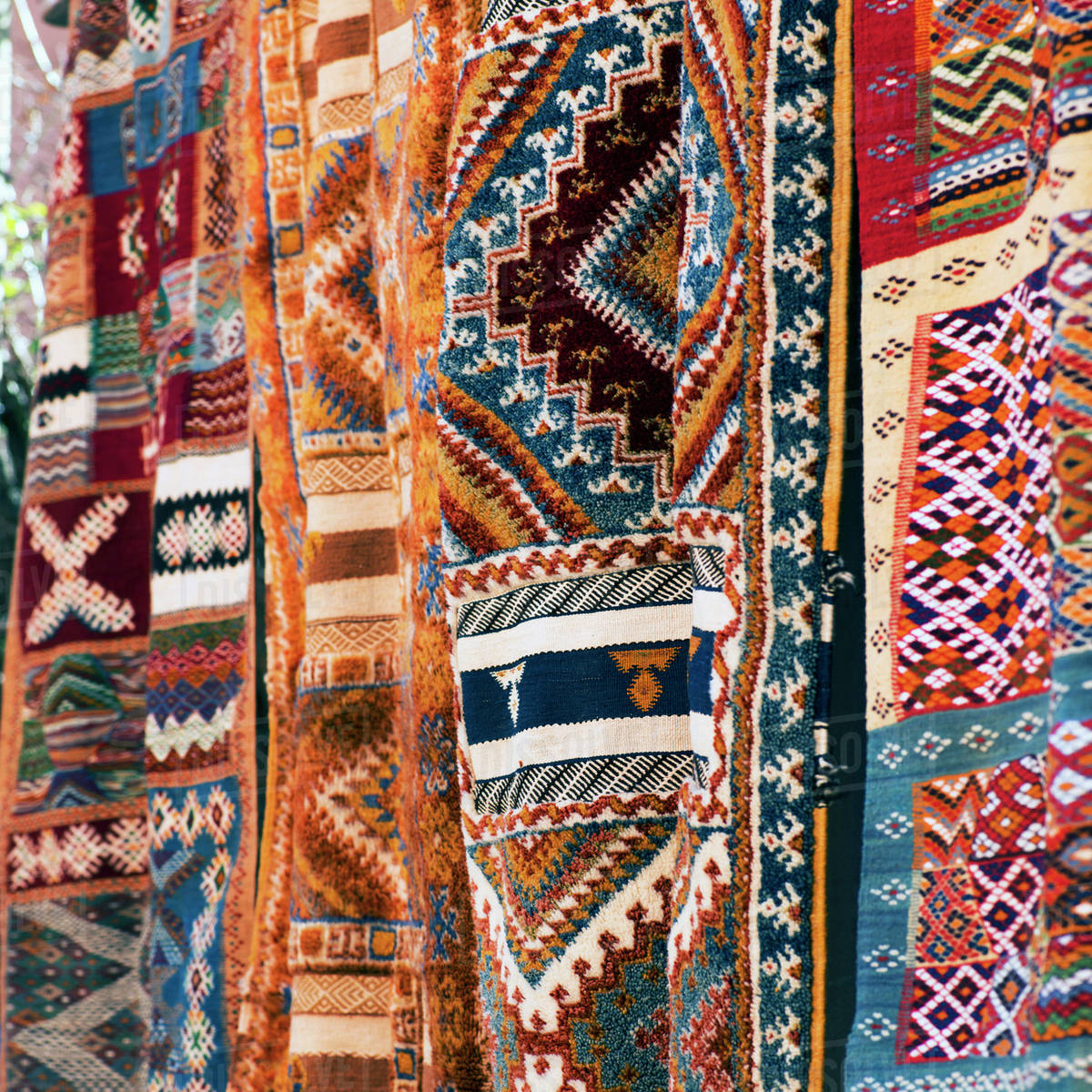 Multi-coloured textiles hanging on display Royalty-free stock photo