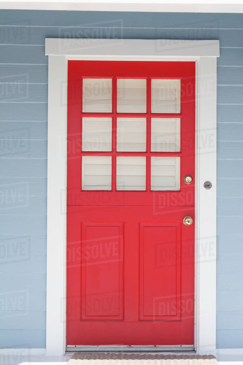 Red Door Framed With White Trim And Light Blue Siding Palm Springs