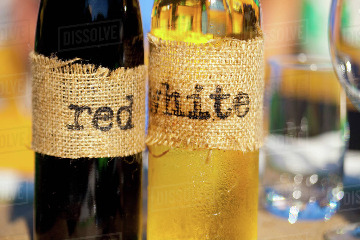 Homemade Wine Bottles With Burlap Labels; Vancouver, British Columbia, Canada