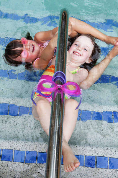 Girls playing in a swimming pool;Gold coast queensland australia Royalty-free stock photo