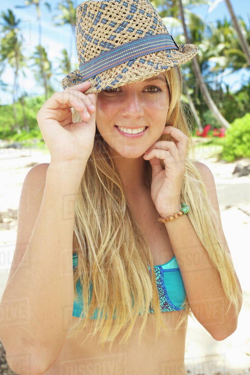 728b00bcc7ae7 A teenage girl on the beach in a two piece bathing suit and hat Maui hawaii  united states of america