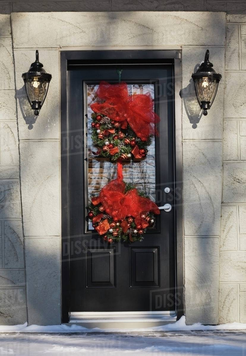 front entrance door on a residential home with christmas decorations in winter quebec canada - Christmas Decorations Canada