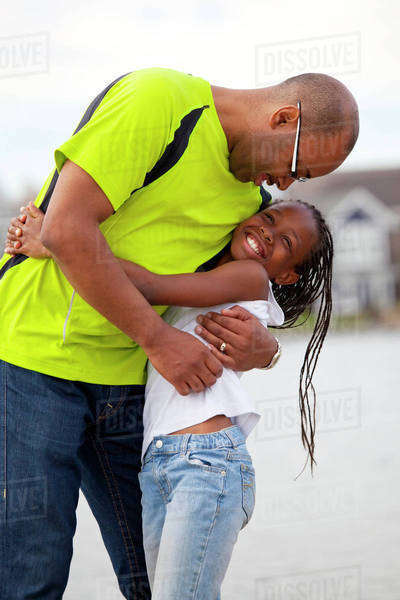 Father And Daughter Having Fun Together Outdoors; Edmonton, Alberta, Canada Royalty-free stock photo