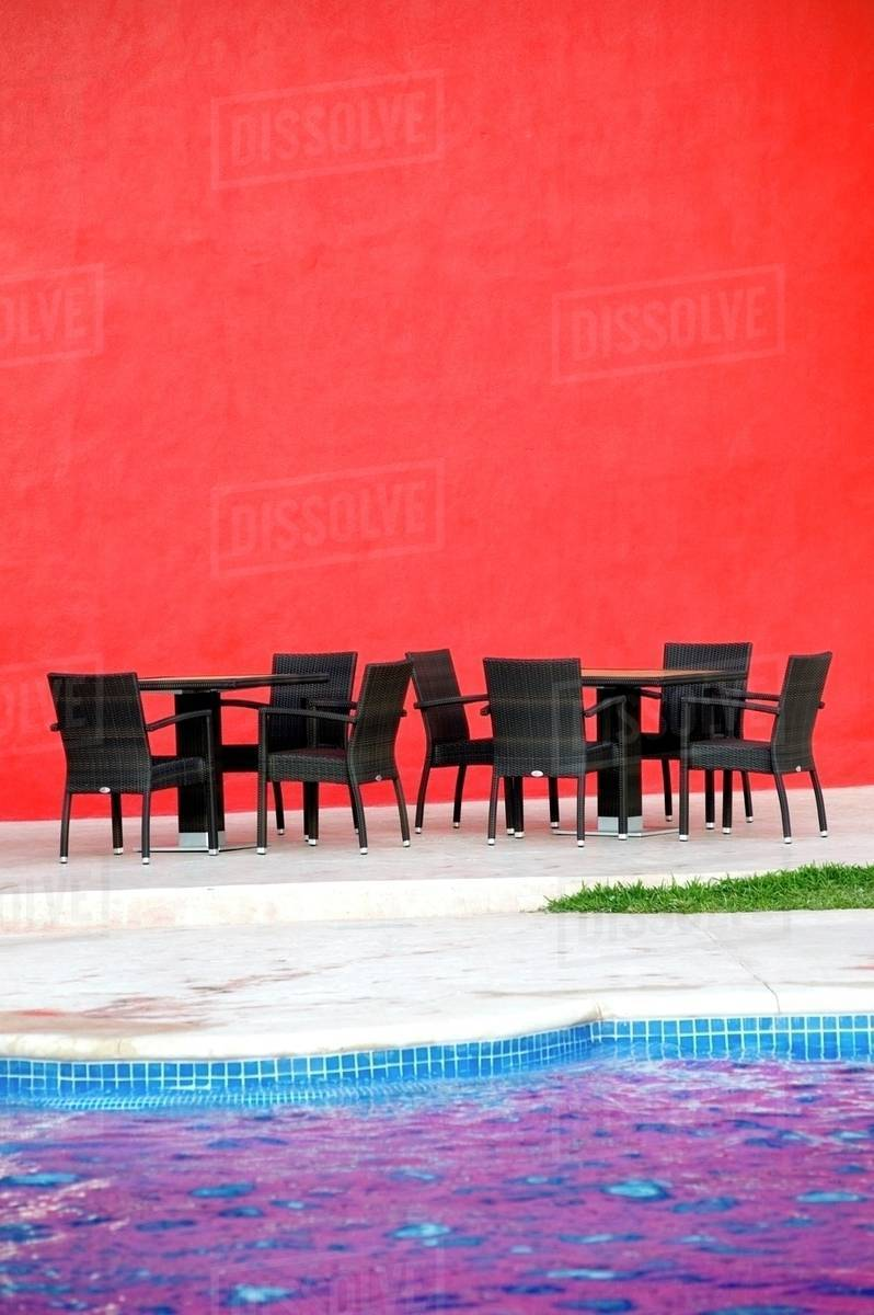 Puerto Vallarta, Mexico; Chairs And Tables By A Pool