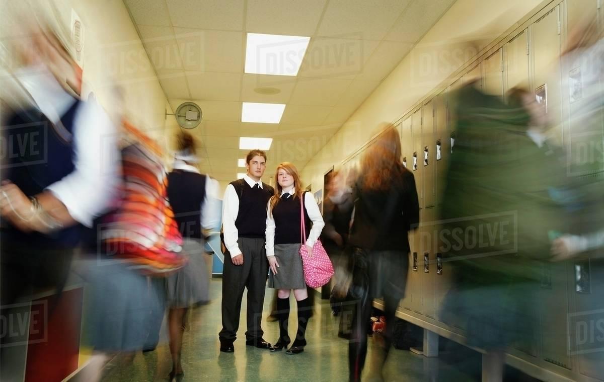 Standing Still In A Busy High School Hallway Stock Photo Dissolve