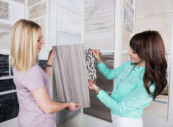 Design consultant and interior designer selecting tiles in