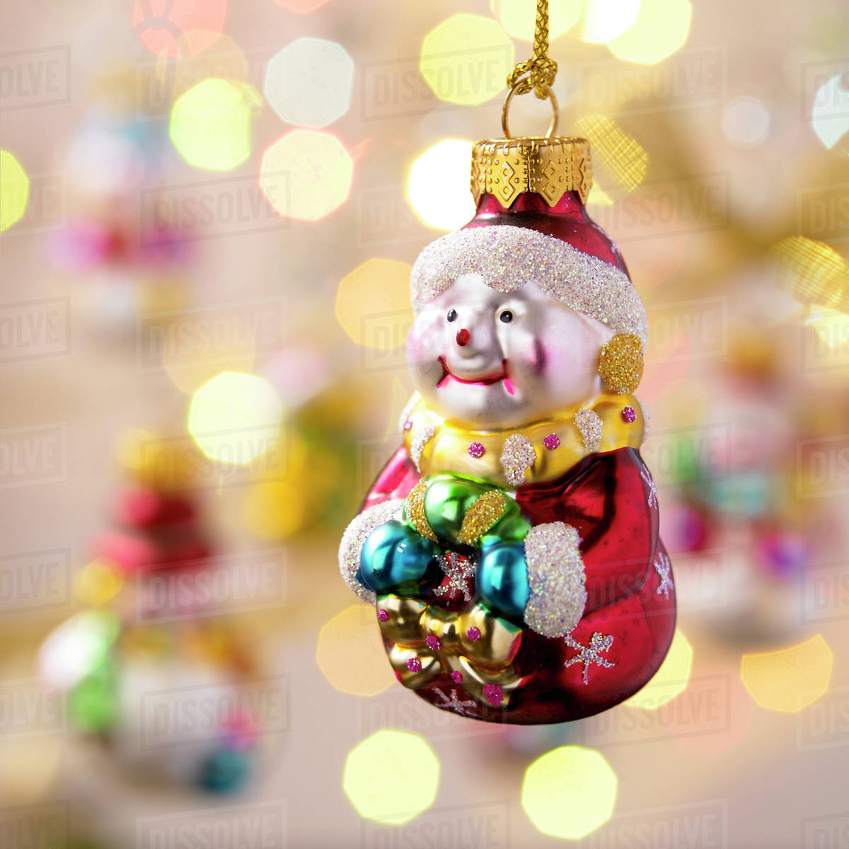 hanging santa christmas ornament with out of focus ornaments in the background victoria british columbia canada