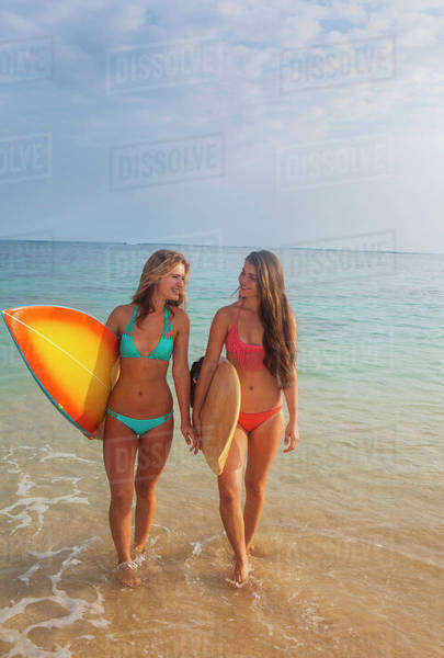 Teenage sisters with their surfboards; Kailua, Island of Hawaii, Hawaii, United States of America Royalty-free stock photo