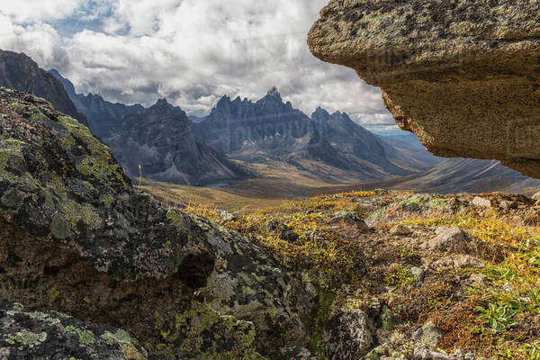 Tombstone Mountain is framed by rocks in this view within Tombstone Territorial Park; Yukon, Canada Royalty-free stock photo