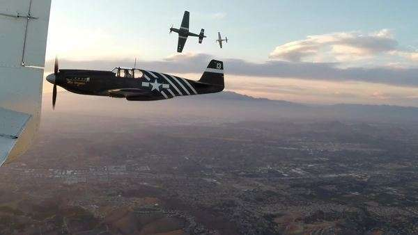 Aerial shot of WWII P-51A Mustang aircraft in Chino, California, USA Royalty-free stock video