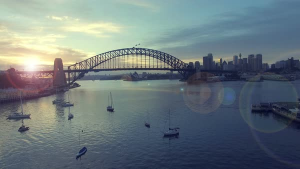 Sydney Harbour Bridge during sunrise. Cinematic look and lens flare effect. Royalty-free stock video