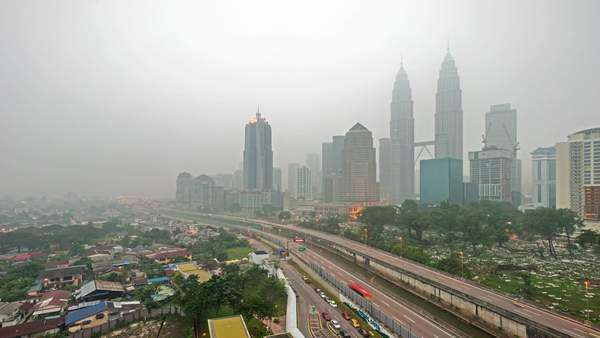 Timelapse . Kuala Lumpur city during severe haze. Pan right to left. Royalty-free stock video
