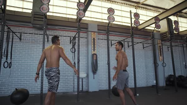 Two men high five each other after completing workout set Royalty-free stock video