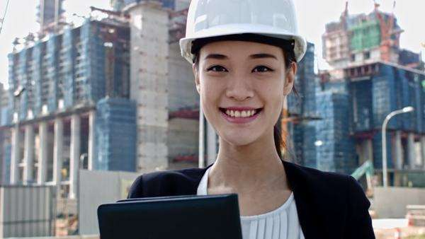 Engineer smiling with construction in Singapore Asia woman Royalty-free stock video