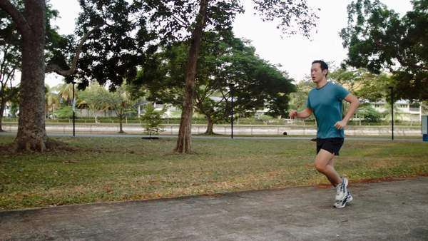 Fit healthy man exercising running in sporty recreation activity Royalty-free stock video