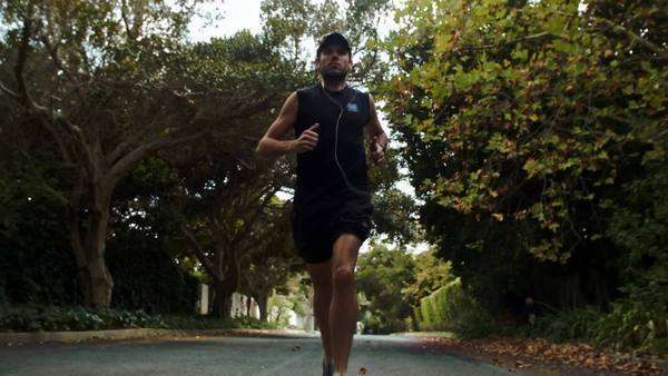 Fit lean man exercise running in the suburbs neighborhood Royalty-free stock video
