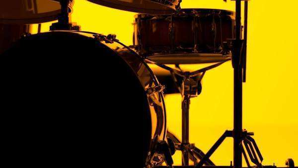 Close-up of drum kit on bright orange background Royalty-free stock video